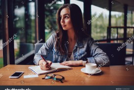 017 Essay Example Looking Out The Window Stock Photo Thoughtful Skilled Author Of And Thinking On Writing Interesting For Stunning My