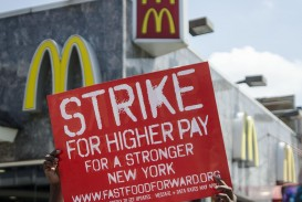 020 Minimum Wage Argumentative Essay Example 1200px July 292c 2013 Protestor Unforgettable Against Raising Persuasive